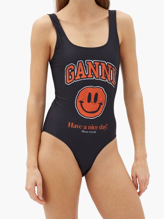 GANNI Smiling face-print recycled-fibre swimsuit 303лв