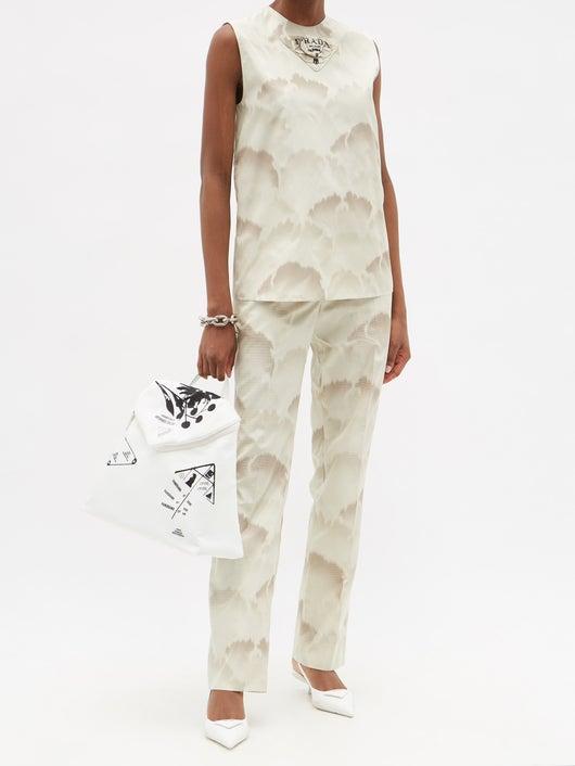 Prada Triangle Logo-patch Cloud-print Silk-taffeta Top 2238лв Prada Cloud-print Silk Crepe de Chine Trousers 3858лв